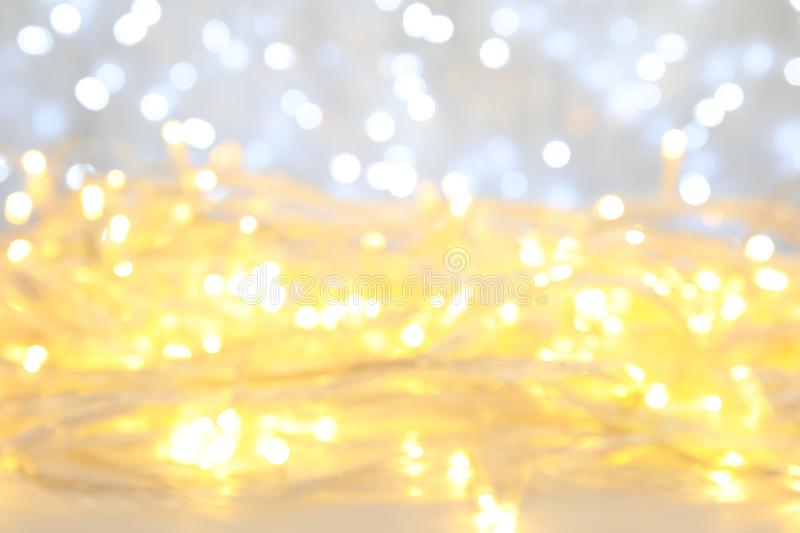 Blurred view of glowing Christmas lights royalty free stock images