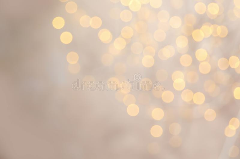 Blurred view of golden Christmas lights as background royalty free stock image
