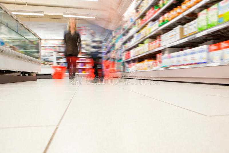 Download Blurred View Of People In Supermarket Stock Photo - Image of grocery, interior: 19472438