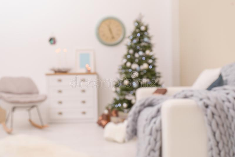Blurred view of stylish living room interior with Christmas tree royalty free stock image