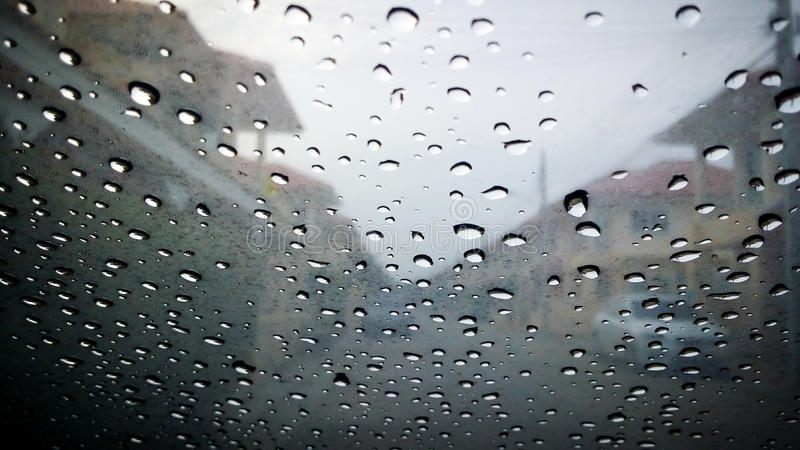 the blurred of water rain drop on car window royalty free stock images
