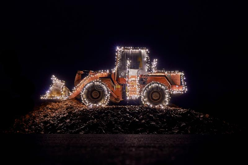 Blurred wheel loader decorated with lights royalty free stock photography