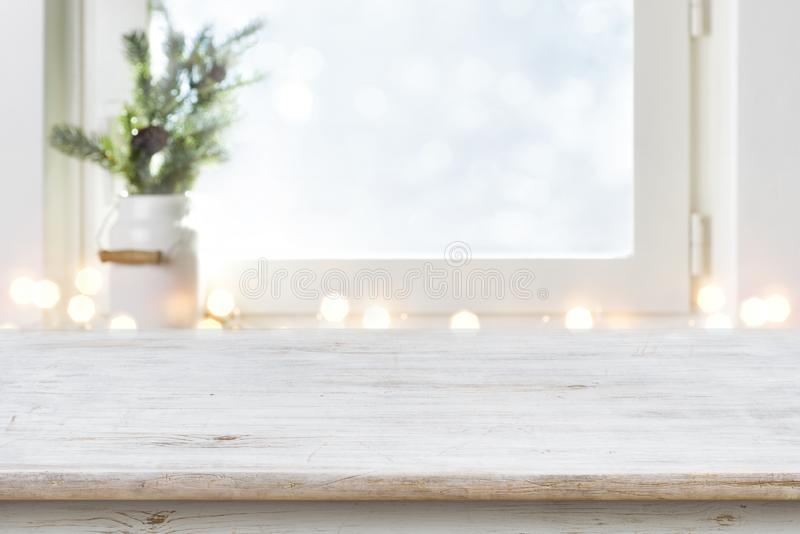 Blurred winter holiday background with vintage wooden table in front.  stock photo