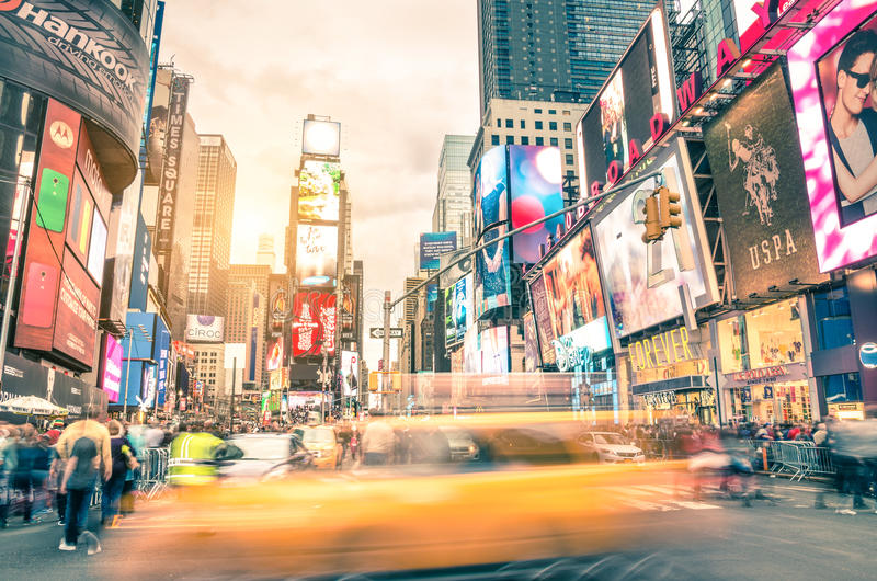 Blurred yellow taxi cab and rush hour in Times Square New York royalty free stock photography
