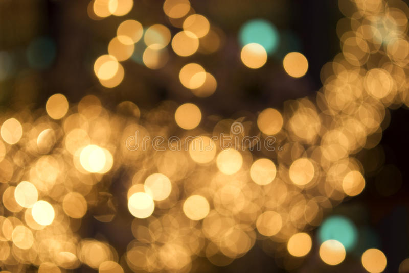 Blurring the light. Abstract golden light blur spots shape of a deer