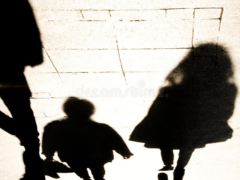 Blurrry shadow silhouete of  people walking in high contrast  black and white royalty free stock photo