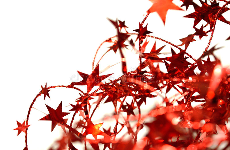Blurry abstract background of red Christmas garland with red stars on white royalty free stock image
