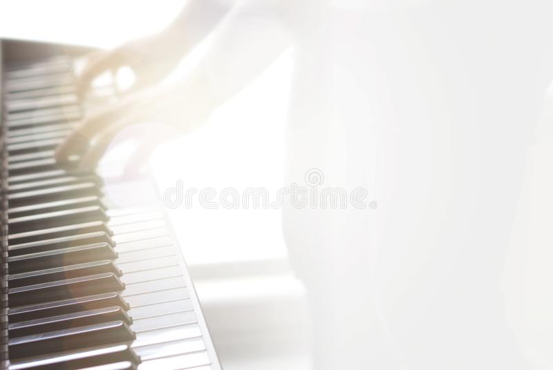 Blurry abstract music background. Playing piano. royalty free stock photos