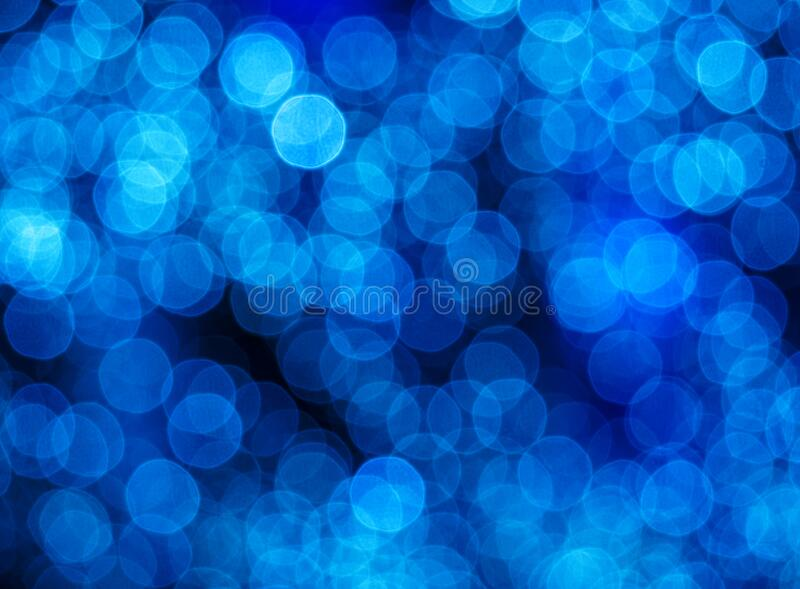 Blurry abstract pattern with glowing blue light spots. Decorative background for holidays royalty free stock photography