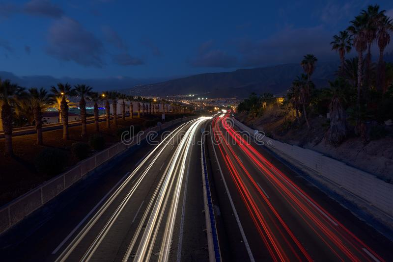 Blurry abstract photo of the lights of cars on the highway. Tenerife Canary islands royalty free stock photos