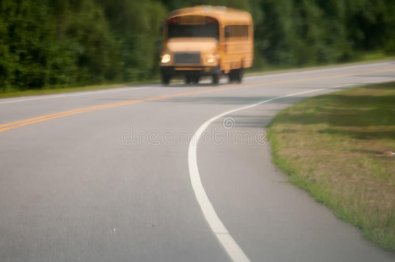 Blurry abstract view of school bus driving on road stock photos