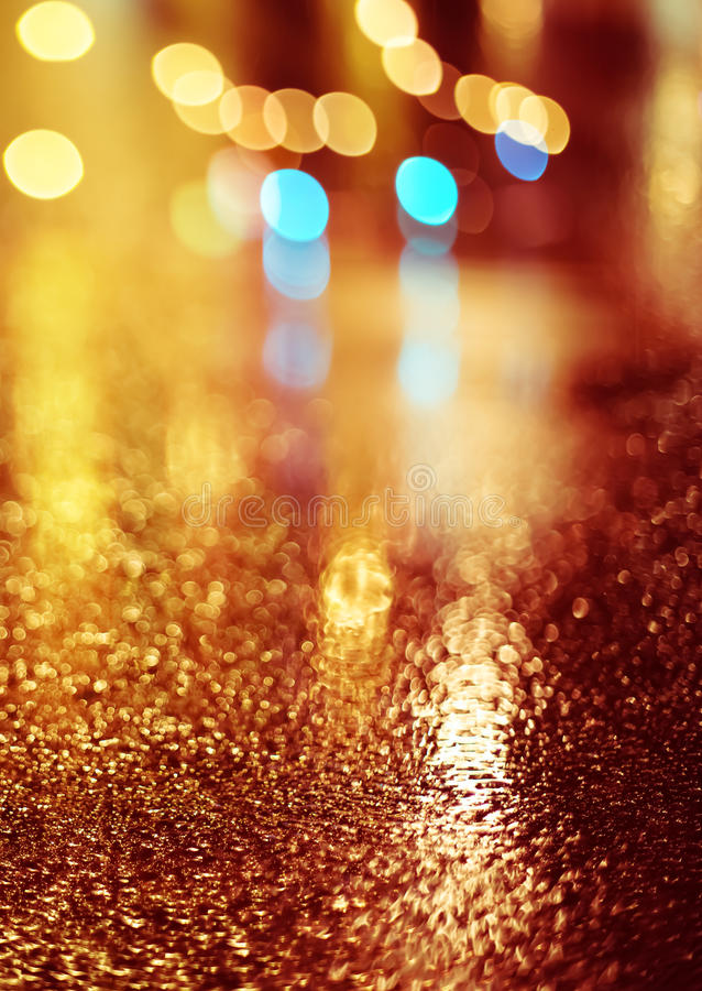 Blurry background. Abstract dark blurry urban background. Wet road royalty free stock photography
