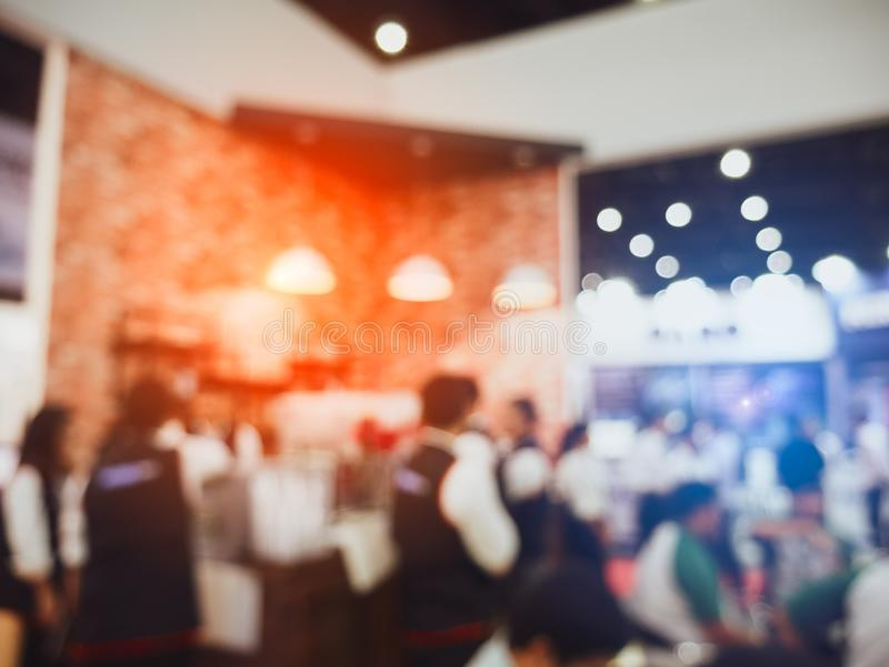 Blurry background coffee shop and crowd people and serving waiter in restaurant. Service and occupation part time job concept. stock photos