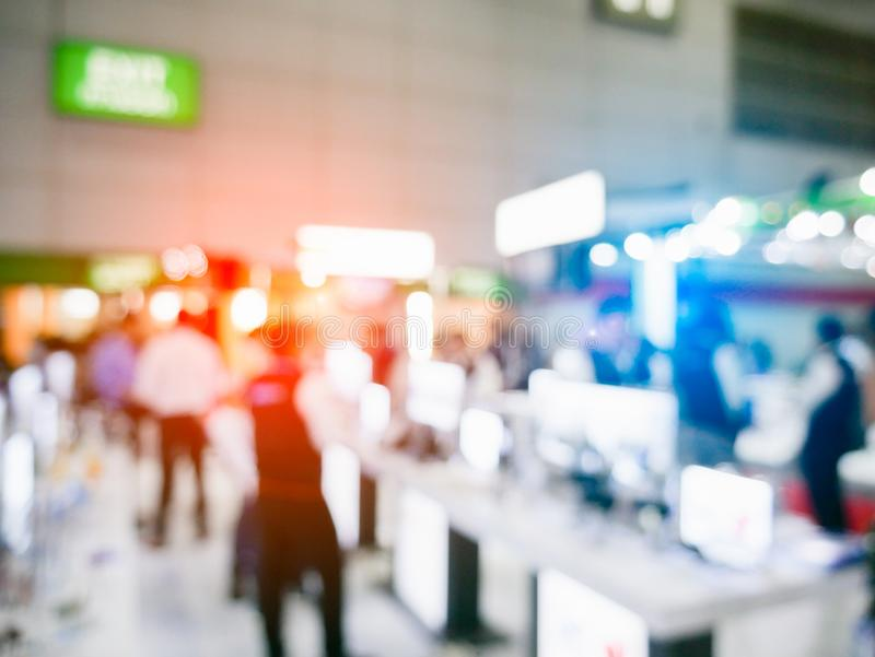 Blurry background of exhibition expo with crowd people in convention hall. Abstract concept. Business marketing and event theme. Department fair and trade show royalty free stock image