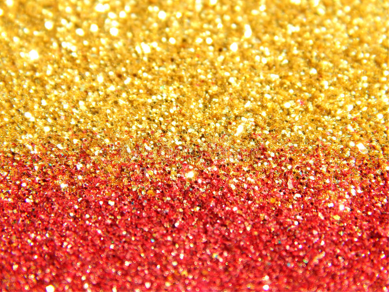Blurry background of golden and red glitter sparkle stock images