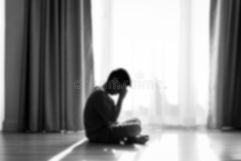 Blurry background Silhouette sad boy crying stock photography