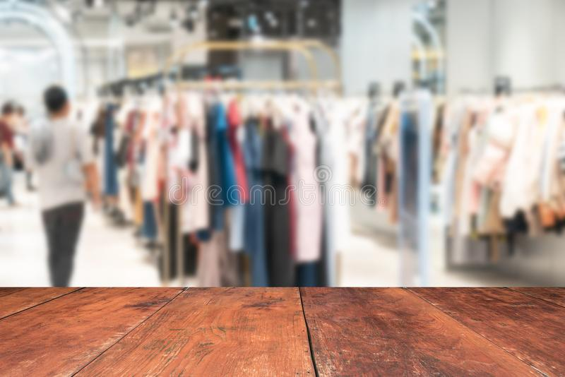 blurry background of Sports clothing store with bokeh image luxury and fashionable brand,can be used for montage or display your stock image
