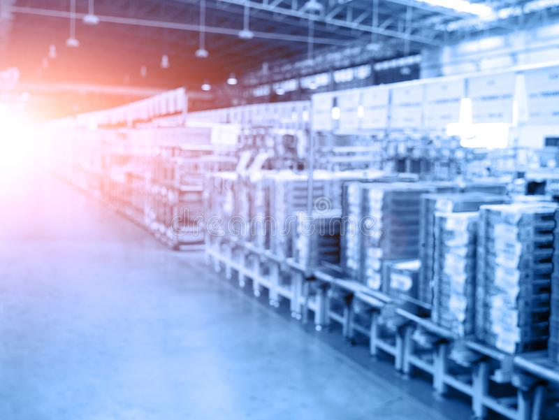 Blurry background of warehouse and storage. Abstract of business concept. Logistics and industrial theme. Blue tone and orange sun. Light element royalty free stock images
