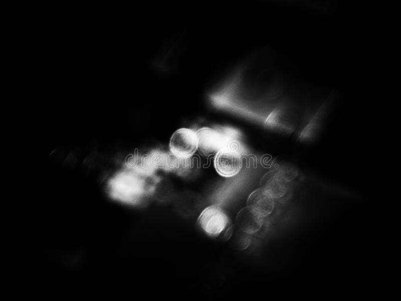 Blurry bokeh background on black and white stock image