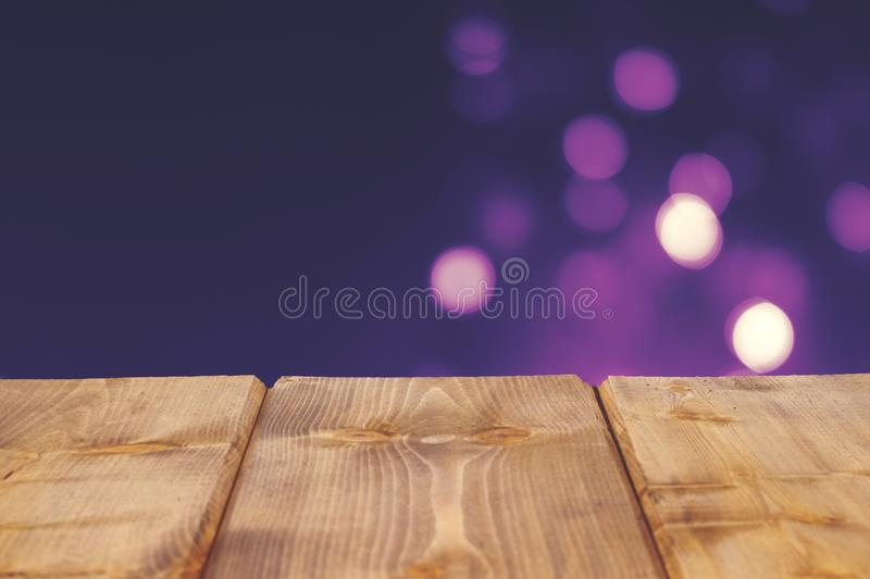 Blurry bokeh cream color background with wood panel floor perspective.montage for show advertising product. royalty free stock image