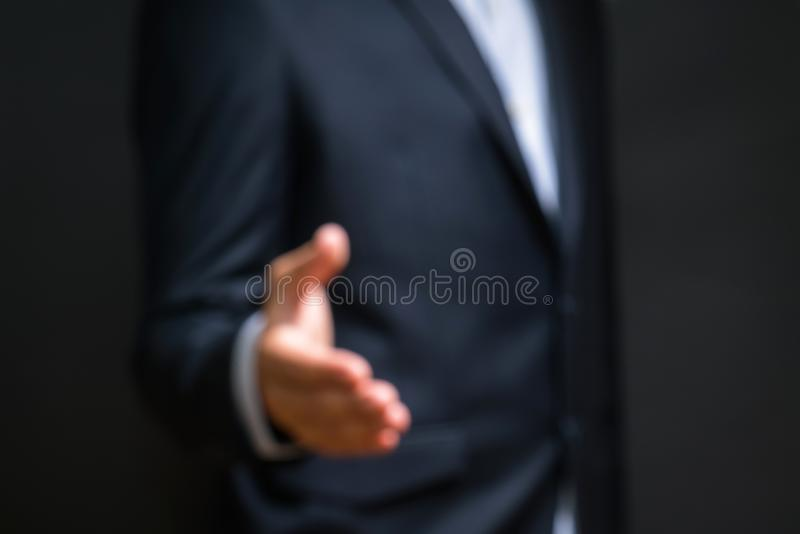 Blurry Business partnership meeting concept. Businessman handshake. Successful businessmen handshaking after good deal. Horizontal, blurred background stock images