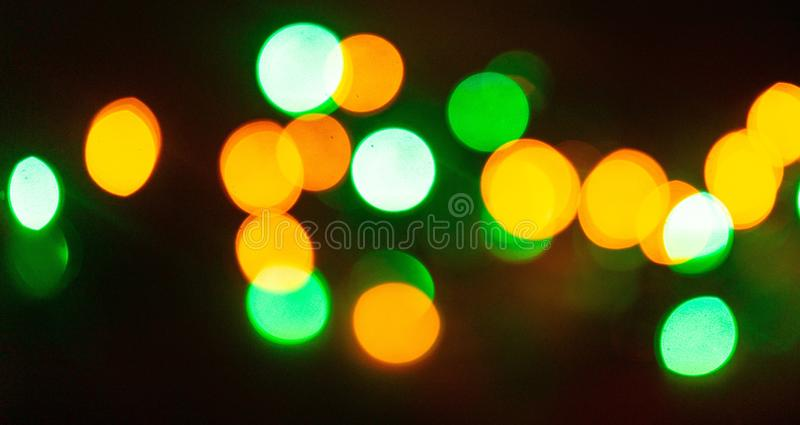 Blurry christmas lights on a Black background stock photo