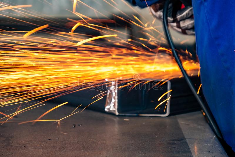 Blurry construction concept background of worker using angle grinder on construction site stock images
