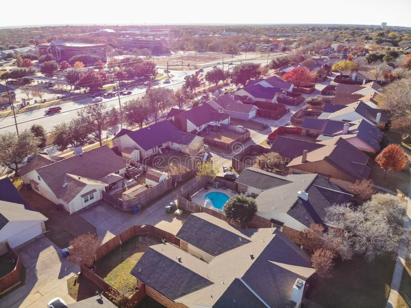 Blurry drone view residential houses with garden, garage and colorful leaves near Dallas. Blurred aerial view residential neighborhood with colorful fall foliage stock photos