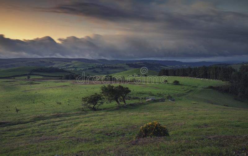 Blurry Dusk Clouds over British Countryside. Dramatic dusk clouds over British countryside fields in Shropshire, UK stock photography