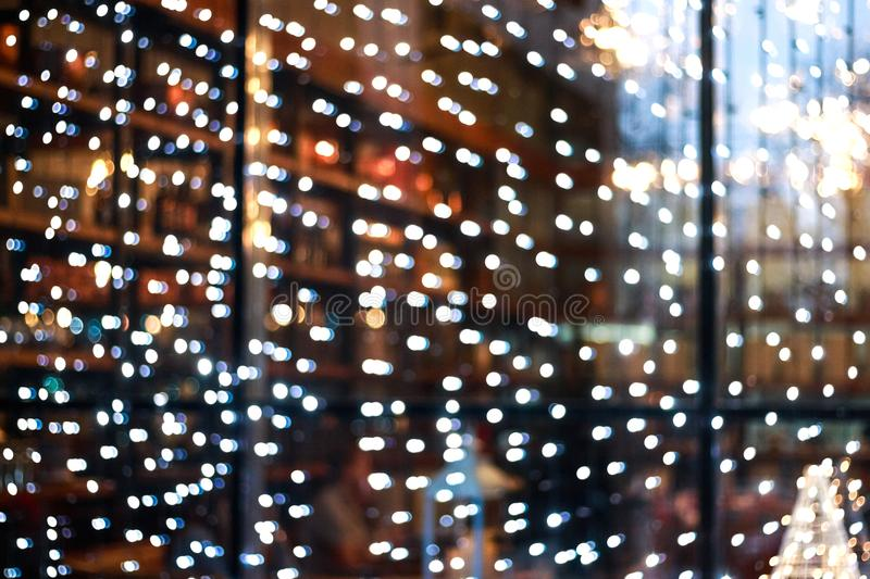 Blurry garlands with bokeh. Christmas lights in the windows royalty free stock photo