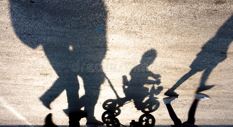 Blurry familly with kids silhouette and shadow royalty free stock photos