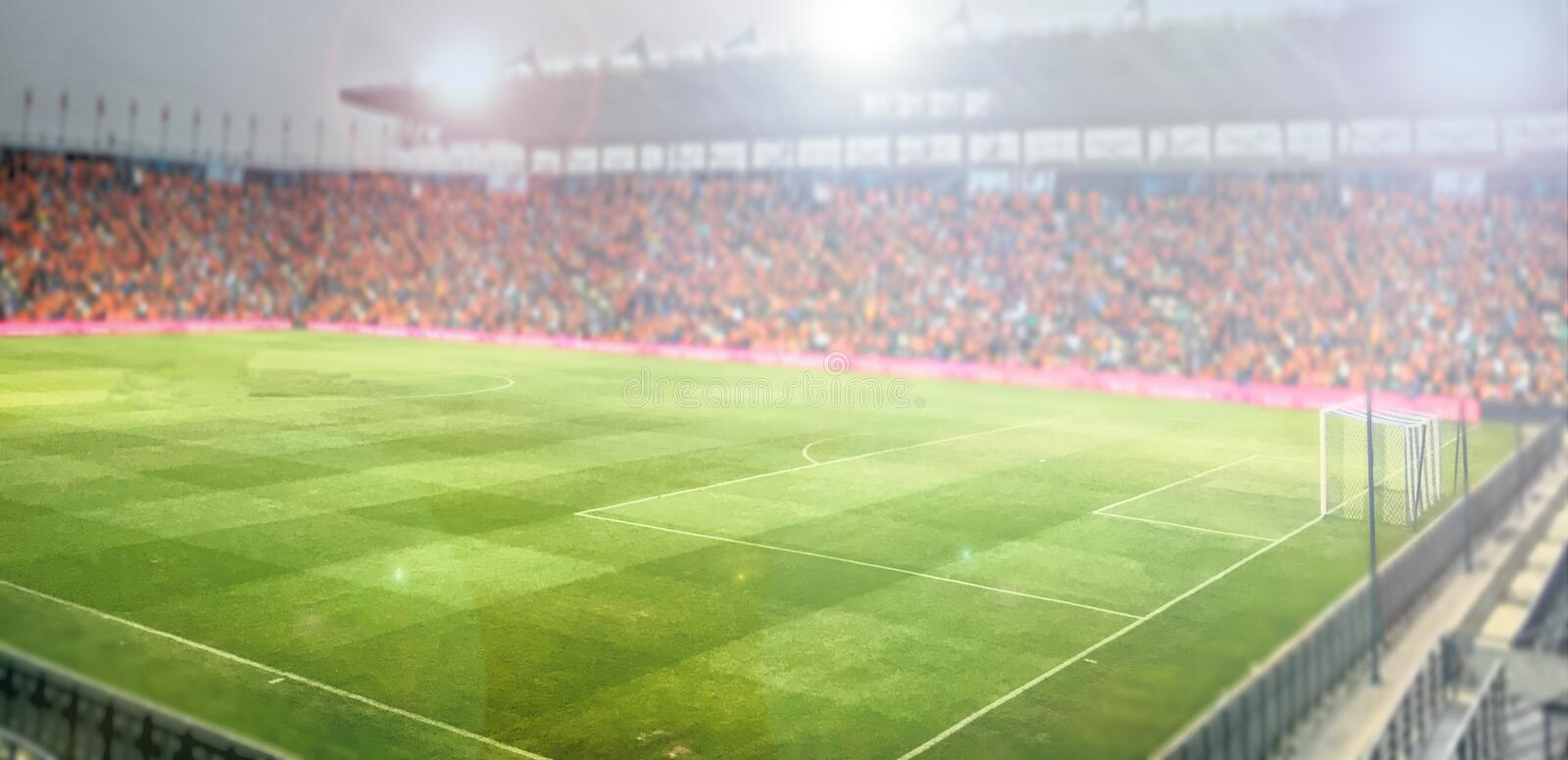 Blurry of football stadium and stadium arena soccer field championship win for background royalty free stock photography