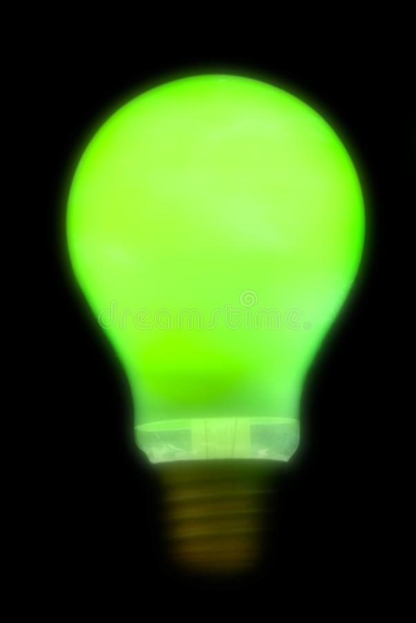 Blurry green lightbulb royalty free stock images