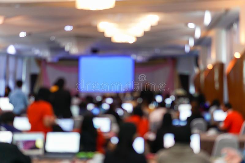 Blurry image in conference room. Abstract blurred people lecture and discussion in seminar room or conference room stock photography