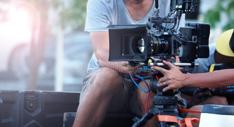Blurry image of movie shooting and light flare. Blurry image of movie shooting or video production and film crew team with camera equipment at outdoor location royalty free stock photos