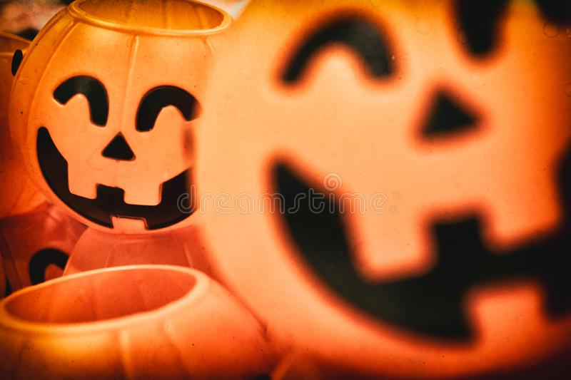 A blurry Jack o`lantern or halloween pumpkins with antique old film camera effect royalty free stock photos