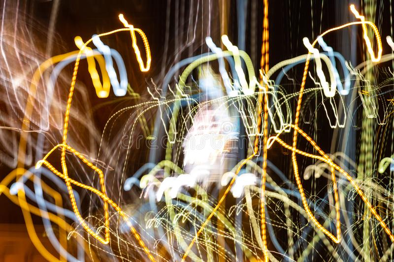 Blurry lights in motion, abstract colorful background.  royalty free stock photos
