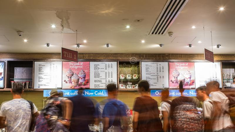 Blurry motion image of people line in cafe shop stock photos