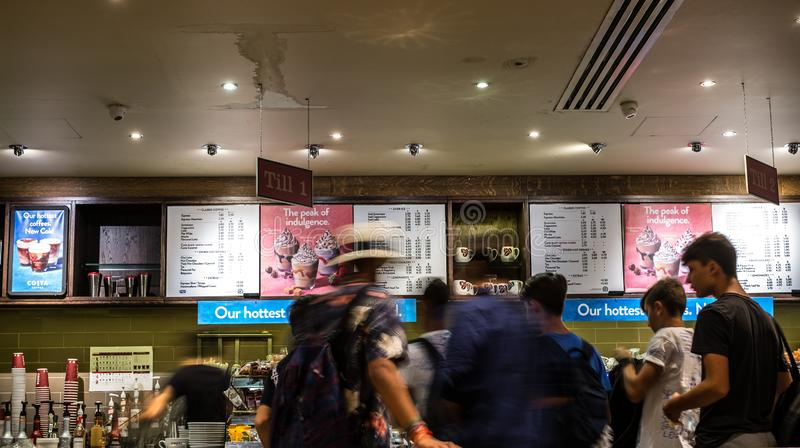 Blurry motion image of people line in cafe shop stock image