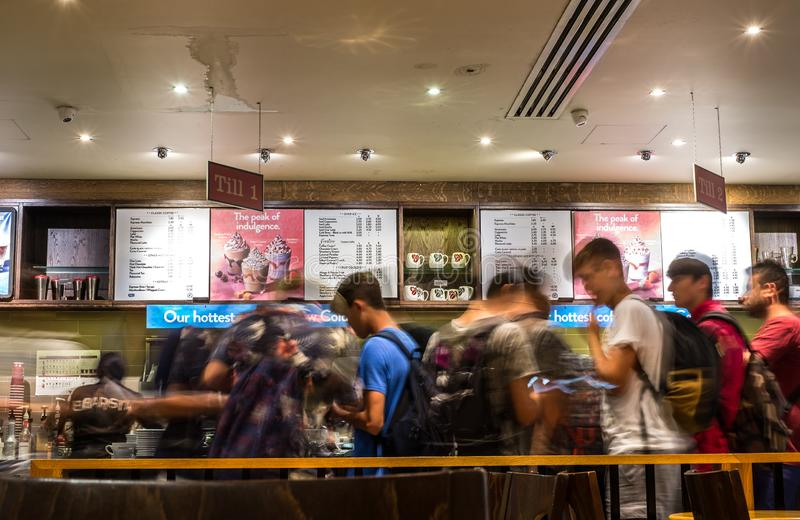Blurry motion image of people line in cafe shop stock photography