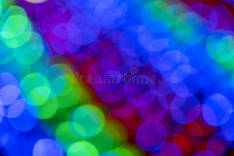 Blurry multicolored garland with glowing lights. Christmas, new year, birthday and wedding concept royalty free stock photos