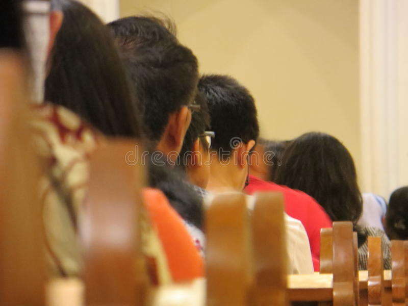 Blurry people at church. SERPONG, INDONESIA - August 12, 2017: Blurry image of people at a church stock photo