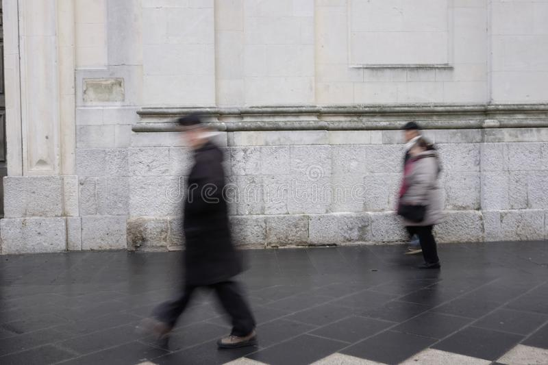 Blurry people walking in the city center royalty free stock images