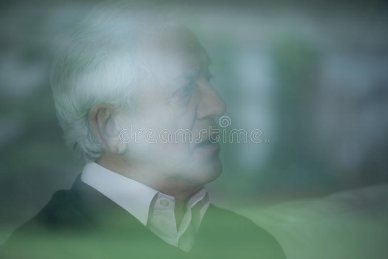 Blurry picture of elder man. With gray hair royalty free stock images