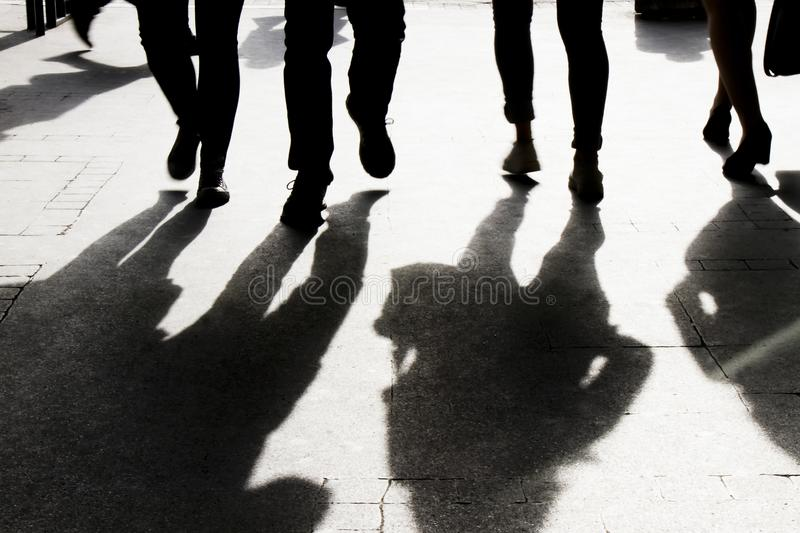 Blurry shadow and silhouette of people walking city streets royalty free stock image