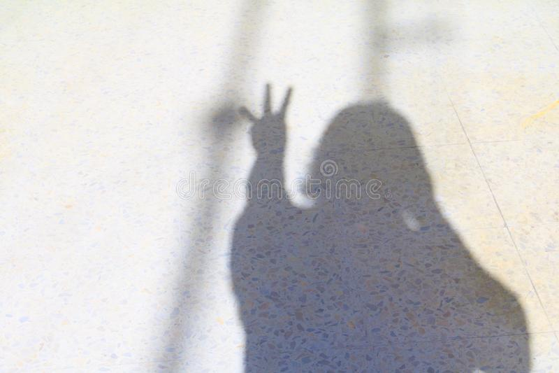 Blurry shadows of people and hand show counting number three on terrazzo floor Halloween Concept royalty free stock images