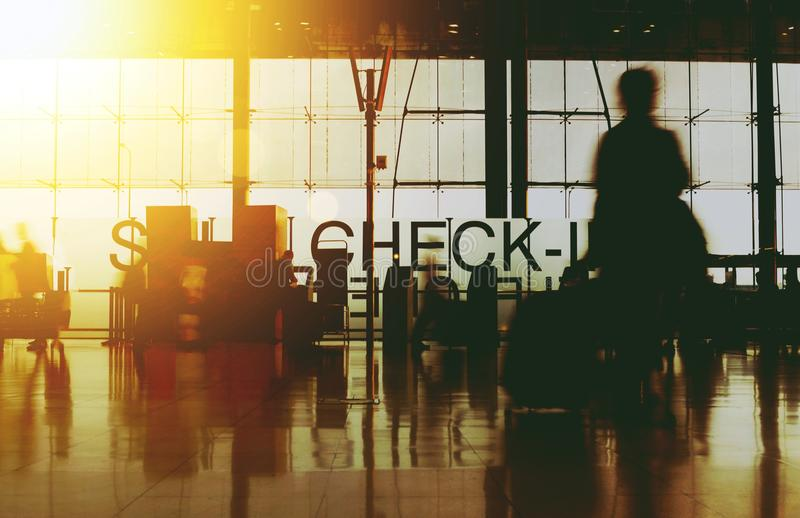 Blurry Silhouette Busy Airport Terminal royalty free stock images