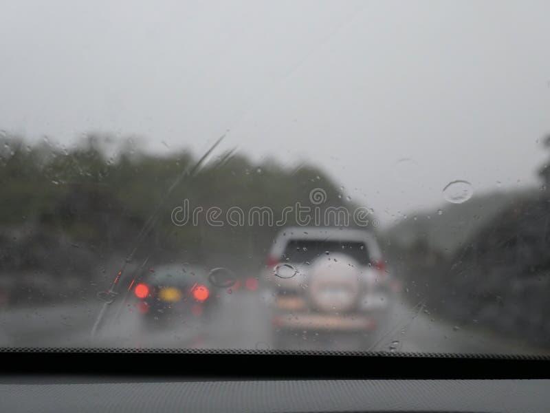 Blurry of traffic. On raining day stock photo
