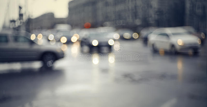 Blurry unfocused background with the city road with cars in twilight royalty free stock photos