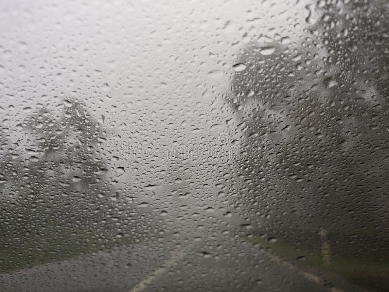 Blurry view of countryside road bad weather. royalty free stock image